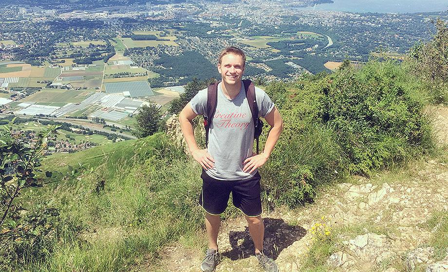 Aaron Johnson standing on a mountain above Geneva, Switzerland.