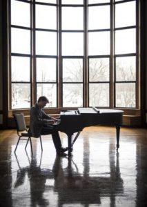 John Aylward playing Piano