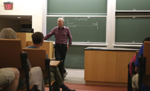 Charlie Bresler, M.A. '83, Ph.D. '84, speaks with alumni at Reunion 2015.