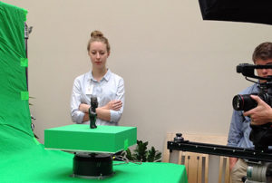 Elisabeth Spak '16 considers the pre-Columbian Olmec Incised Standing Figure at a video shoot.