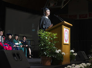 Magaly Preciado Reyes speaking at graduation