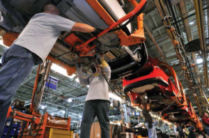People working in a car factory