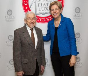 U.S. Senator Elizabeth Warren poses for a photo with Lee Gurel, '48
