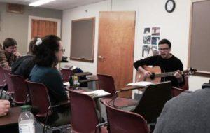 "Clark University sophomore John Hite performs the Norberto Stuart poem ""Mama Mártir"" to a tune he composed."