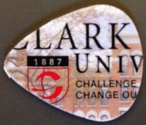 Guitar pick made from Clark University student ID card