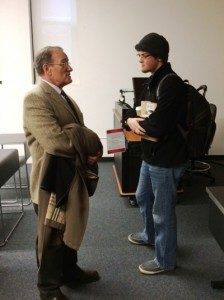 Sophomore Steven Isaacson continues the conversation with guest lecturer Jeffrey Alexander before leaving Prof. Robert Boatright's political science class (Dec. 2).