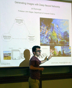 Jiri Roznovjak makes a five-minute presentation about his research.
