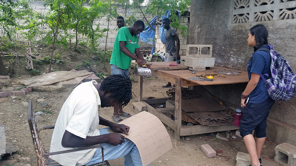 Artisans work in a craft village in Haiti
