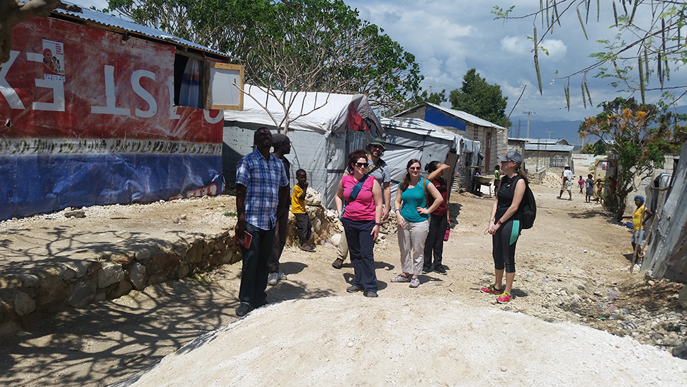 Jude Fernando's students walk through a refugee camp in Haiti