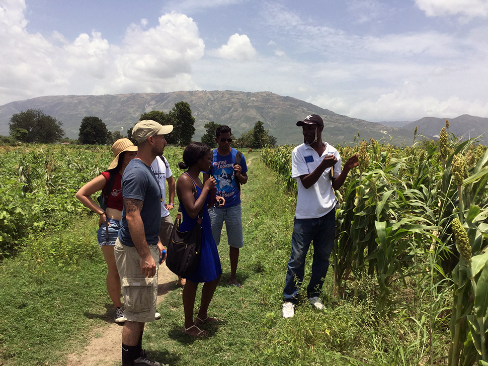Jude Fernando's students listen during agricultural field work