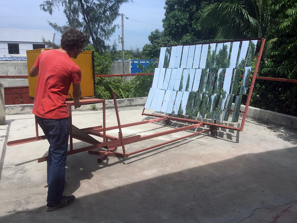 A student demonstrates solar panels in Haiti