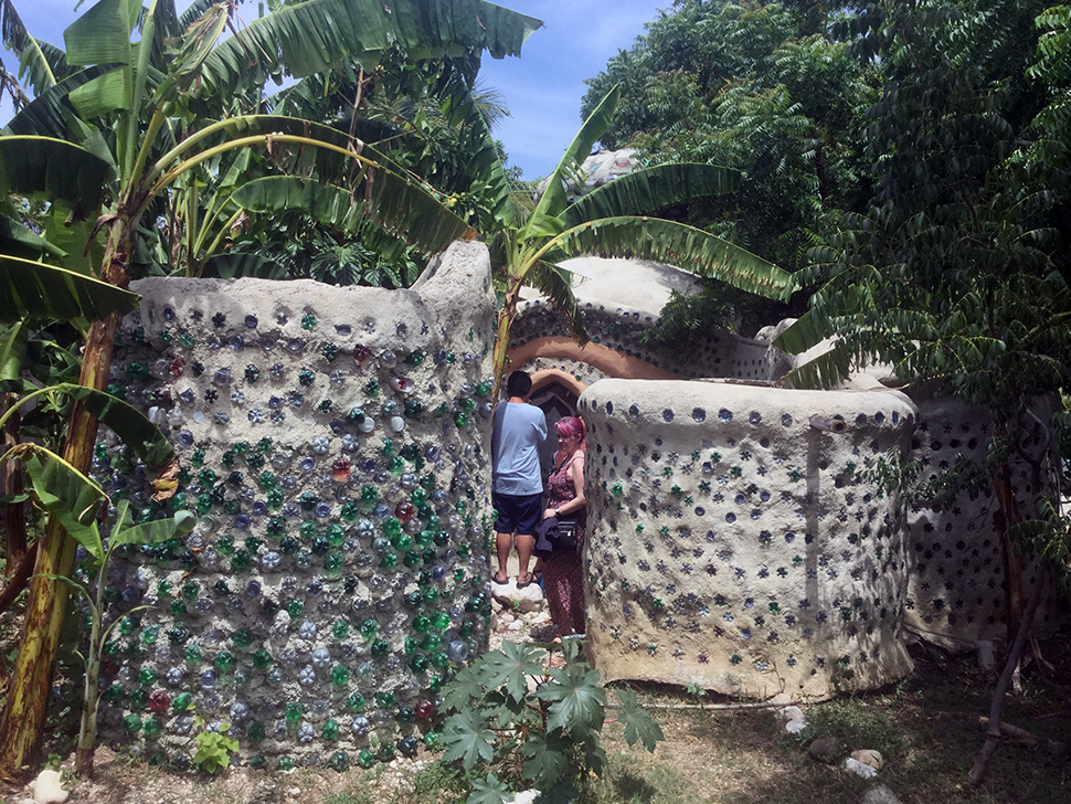 Students examine a superadobe structure in Haiti