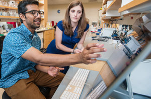 Navid Al Hossain '18 works with Assistant Professor Jacqueline Dresch on his research project.
