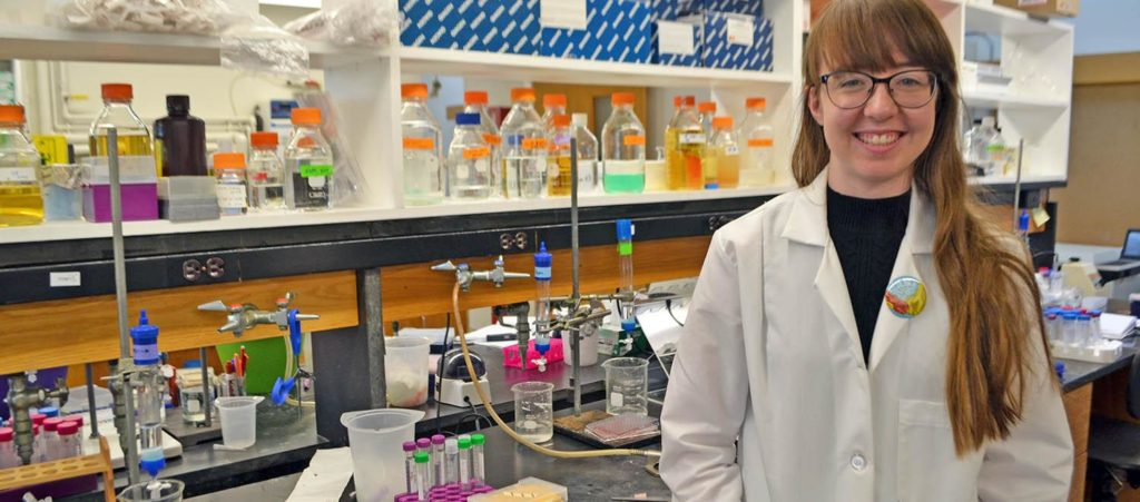 Rachel Orlomoski standing in the chemistry laboratory at Clark University