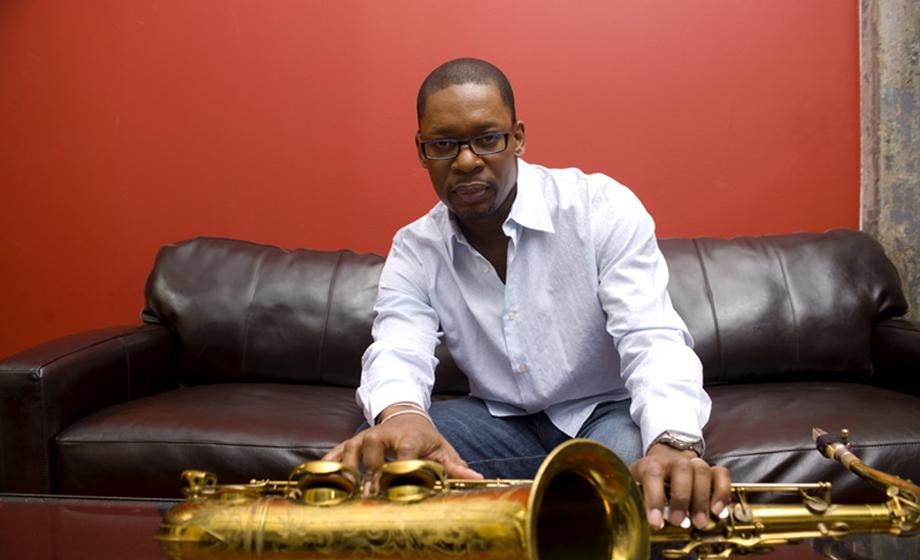 Ravi Coltrane showing sitting with his brass instrument