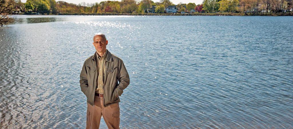 Robert Johnston standing in front of pond