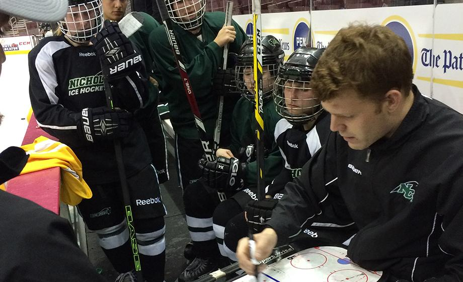 Master's degree candidate William Brown coaches the Nichols College women's ice hockey team