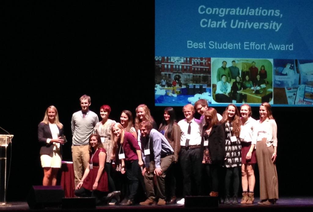 Clark Composts! collaborators from Clark University accept the MassRecycle award for Best Student Effort, on Nov. 6 at the Hanover Theatre in Worcester. Check below for a link to a video of the award presentation.