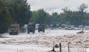 National Guard trucks enter Lyons, Colo. in the days after the flood. Courtesy Kenneth Wajda Photography