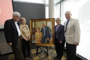 Former President John Bassett and his wife, Kay, with the portrait that now hangs in the Bassett Admissions Center, along with artist Charlotte Wharton '80 and President David Angel