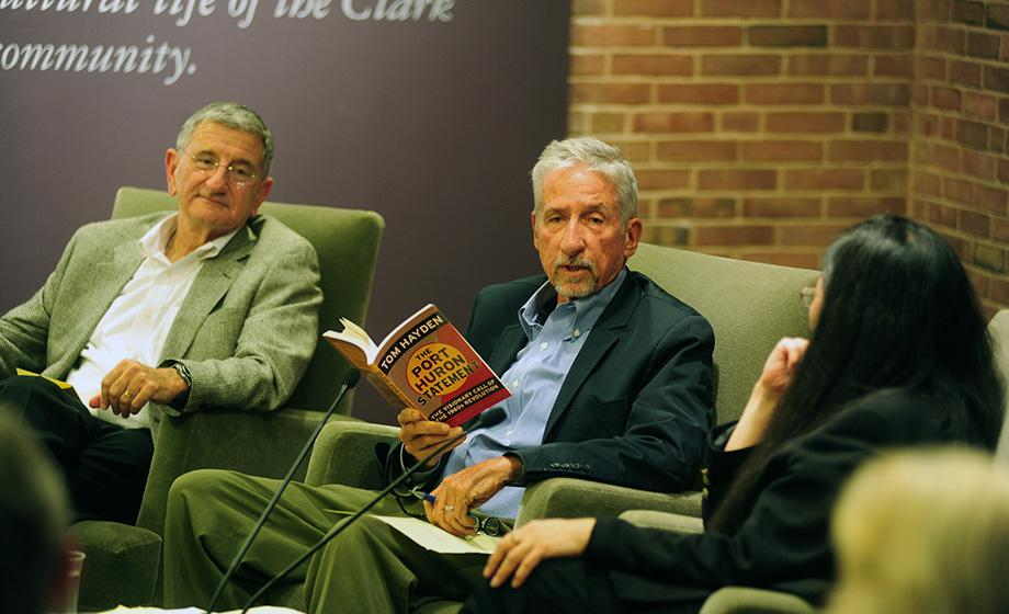 "Activist Tom Hayden speaks at Clark during a Difficult Dialogues symposium on Engagement and Citizenry in 2011 as Prof. Robert ""Bob"" Ross looks on at left. Prof. SunHee Kim Gertz is seated at right."