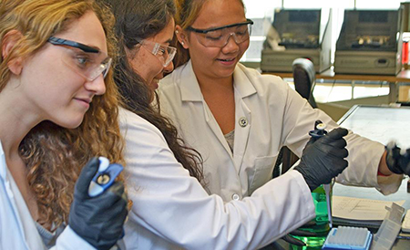 From left, Lara Prosterman '17, Emilie Ogisu '17 and Pinky Htun '17 purify proteins in the laboratory. Their work in the lab last summer was sponsored via Clark's Interdisciplinary Summer Research Program; they have continued to work in the lab this year.