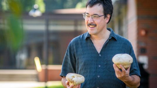 David Hibbett holding mushroom