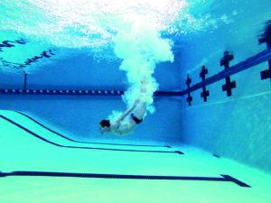 Steve Castiglione dives in a pool