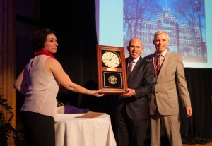 Scott Rechler '89 receives the gift of a clock from Director of Alumni Affairs Aixa Kidd and President David Angel.