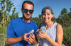 Anthony Himmelberger and Hannah Corney hold baby loggerhead turtles