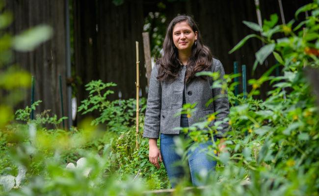 Priyanka K. Naithani standing in a garden