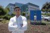 Teodor Nicola-Antoniu standing in front of NetApp sign outside building