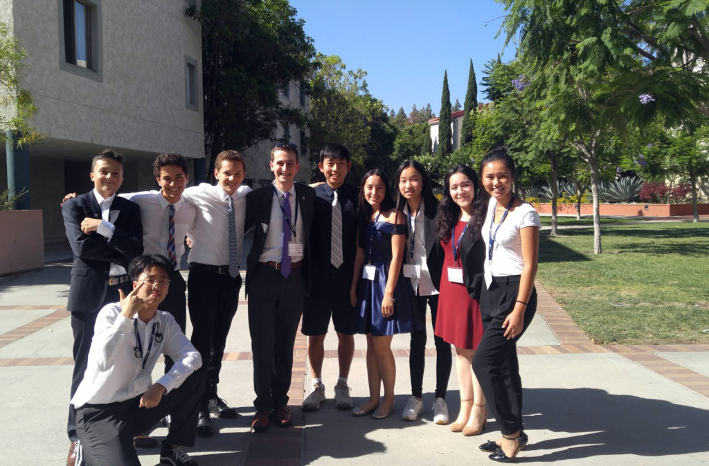 Curan A. VanDerWielen poses with students from UCLA