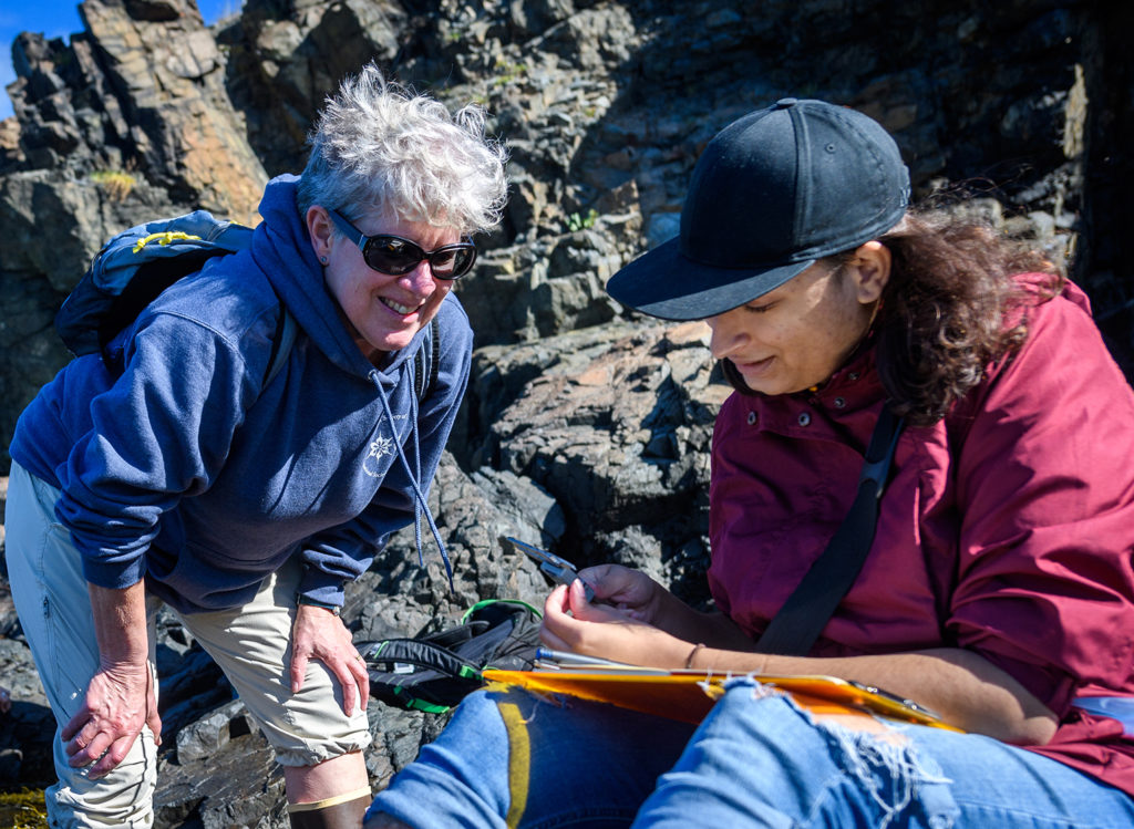 Professor Deb Robertson with a student near the ocean
