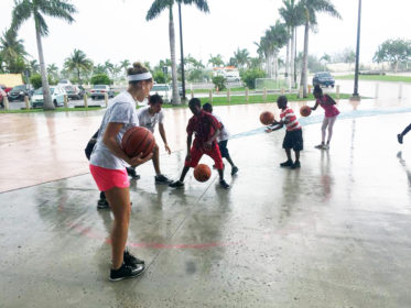 Maggie Tarbox plays basketball with children as part of Project Limestone in the Bahamas.