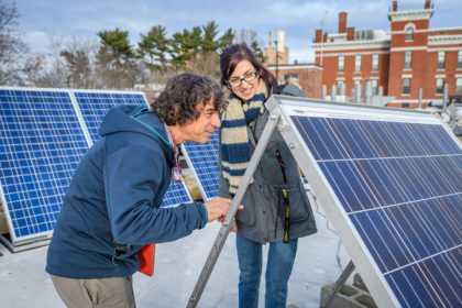 Chuck Agosta and Megan McIntyre looking at solar panels