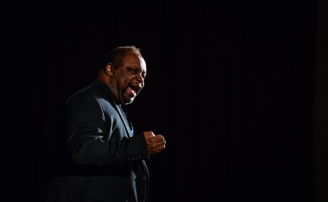 Ron Jones performing on stage at Clark University