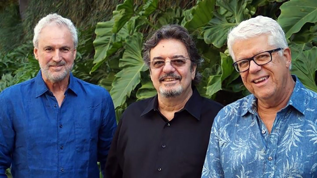 Three members of Trio da Paz standing