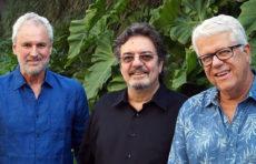 Three members of Trio da Paz standing
