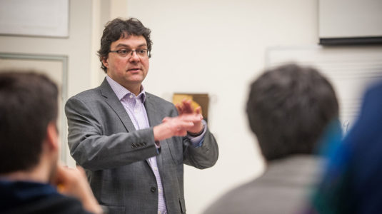 Music Professor Benjamin Korstvedt talks to an audience