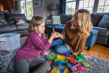 Allegra Denehy '95 and her daughter, Tessa, play at their house