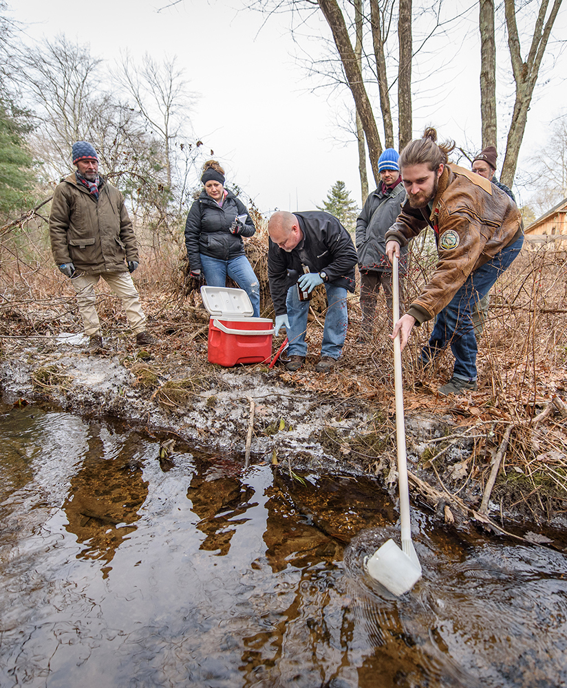 IDCE students take water samples in Uxbridge, Mass.