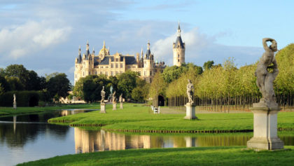 Schwerin Schloss, or Castle, in Germany, with pond in foreground