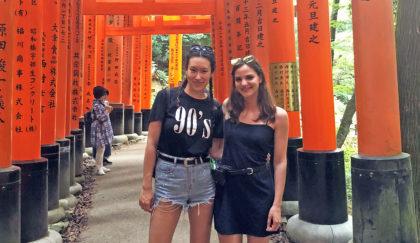 Tiffany Kayo and Christine Zymaris standing in Fushimi-Inari Taisha in Japan
