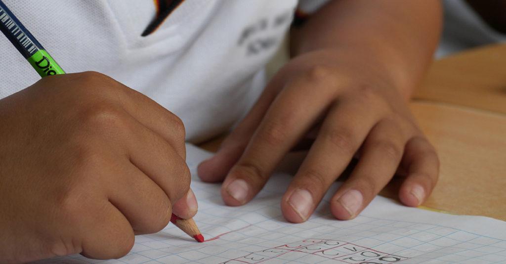 elementary school student writing