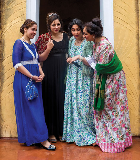 Laaleen Sukhera with friends at an Austen tea.