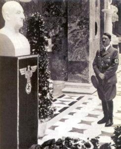 Hitler looking at marble bust of Anton Bruckner