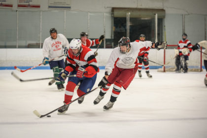 Clark alumni and current student-athletes skate in the annual alumni hockey game
