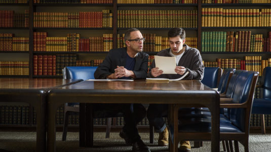 Professor Robert Tobin and student Griffin Minigiello research the history of LGBTQ+ at Clark