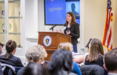 Denise Hines speaks at the 10th annual Family Impact Seminar at the Massachusetts State House